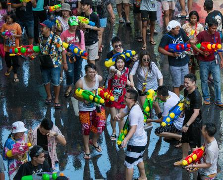 BANGKOK, THAILAND - April 15, 2019 : people happy and funny playing water in Songkran festival at Silom Road in Bangkok.