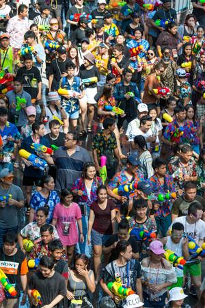 BANGKOK, THAILAND - April 15, 2019 : Crowd of people celebrating the traditional Songkran New Year Festival, Silom road, Bangkok.
