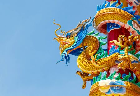 chinese culture: colorful dragon statue  and beautiful dragon with blue sky