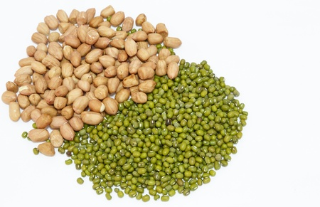 peanuts and green mung beans isolated on white background photo