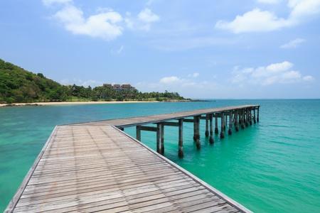 Wooden footbridge over water near the beach