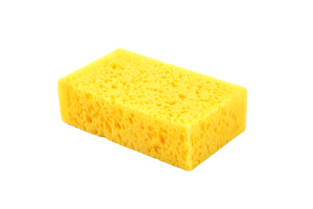 yellow sponge isolated on white background photo