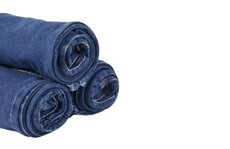 slacks: lot of blue jeans isolated on white background Stock Photo