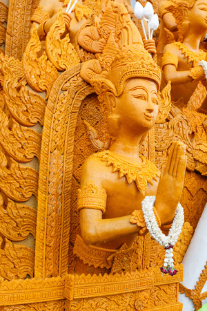 nakhon: Thai style candle wax carving in the traditional candle procession festival of Buddha, at  Nakhon Ratchasima,Thailand Stock Photo