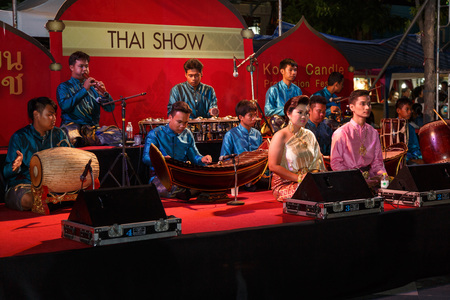 NAKHON RATCHASIMA, THAILAND - JULY 11: A group of Thai music show on the traditional candle procession festival of Buddha,on July 11, 2014 in Nakhon Ratchasima, thailand.