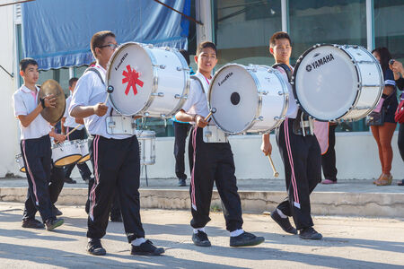 strutting: RAYONG, THAILAND - NOVEMBER 20, 2014 :An unidentified marching band in annual sports day  on November 20, 2014 at Rayong Province, Thailand. Editorial