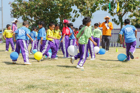 RAYONG, THAILAND - NOVEMBER 20, 2014 : Unidentified Children   balloon team in annual sports day on November 20, 2014 at Rayong Province,Thailand