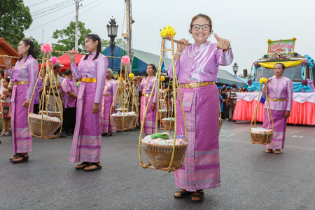 ratchasima: NAKHON RATCHASIMA, THAILAND - MARCH 23:Unidentified thai people in the parade at annual festival Thao Suranaree monument on March 23, 2015 in Nakhon Ratchasima or Korat, Thailand.