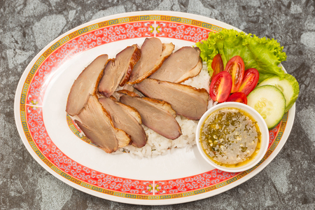 roasted duck meat topping rice dressing sweet sauce and pickled ginger on plate