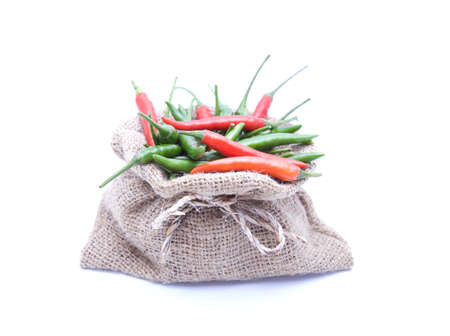green chilli: Red and green chilli and brown sack on White isolated