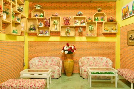 cane sofa: Sofas and brick walls orange.