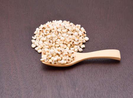 robbing: millet grains on the wooden floor