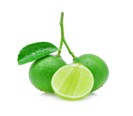 limes with water drops isolated on white.
