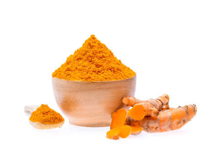 Turmeric roots with turmeric powder on white background Фото со стока