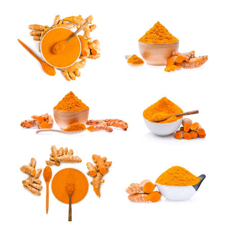 Turmeric roots with turmeric powder on white background Stock Photo