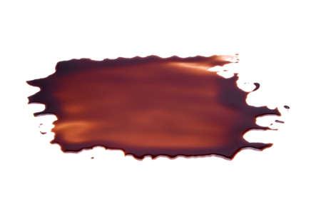 Chocoladesaus op een witte achtergrond Stockfoto