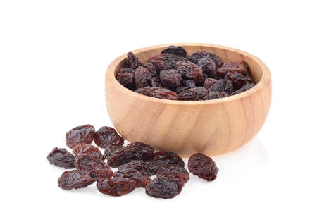 raisins in a bowl isolated on white background