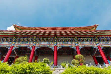 Chinese temple daylight and graden on blue sky photo