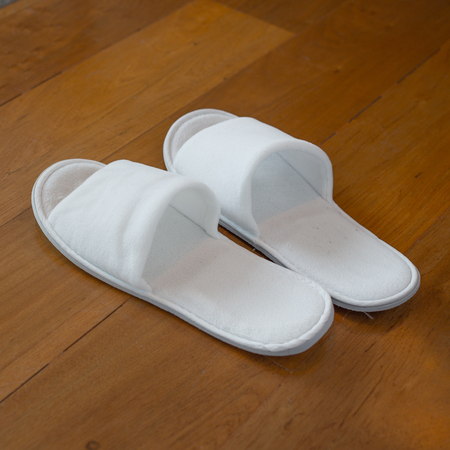 white wood floor: White Slipper on Wood Floor
