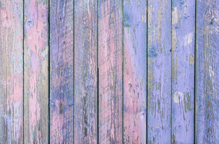 Indigo blue wooden planks background - Colorful outer fence deteriorated by time - Closeup of wood board painted surface - Fashion background with vintage color - Original color focus from middle