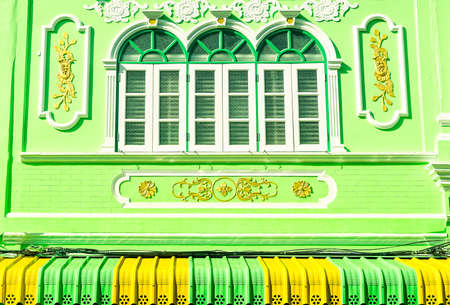 colonial building: Old windows of colonial building facade Sino-Portuguese architecture in Phuket town Thailand - Colorful house frontage old european style Stock Photo