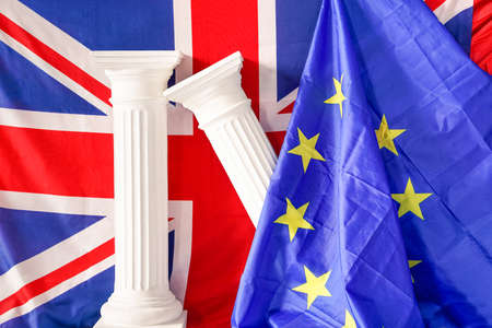 greek columns: United Kingdom of Great Britain and European Union flags with classical greek columns fall - Current concept of next British referendum about in or out EU and related economics political factors Stock Photo