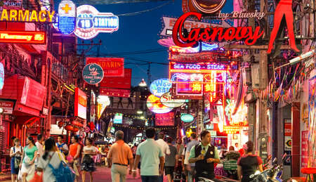 PATTAYA , THAILAND - JANUARY 14 ,  2016:  unidentified crowd of people under the neon signs at Walking Street in Pattaya on January 14 , 2016. Walking street is  popular for clubs bar and night life