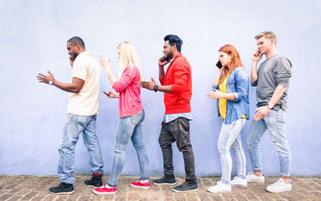 Multiracial row of young people using mobile phone walking on urban street - Teenagers queue talking at cell outdoor on blue background - Concept of addictiont to technology - Focus on red hair girl