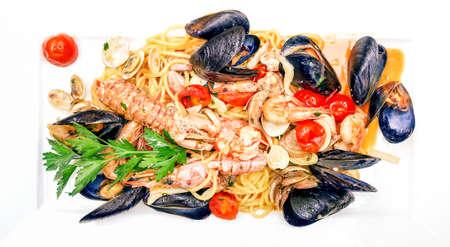 Seafood spaghetti fish sauce top view image on white porcelain rectangular dish Stock Photo
