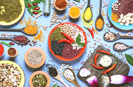 Assortment of legumes and various bowls top view - Healthy food background Stock Photo