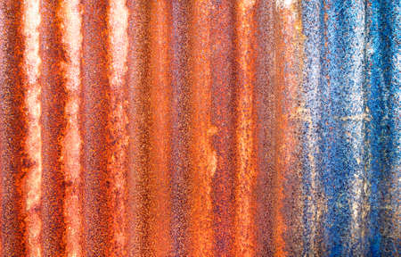 Rusty corrugated metal sheet background - Old galvanized steel panel orange  blue color with vertical lines