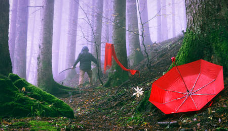 Murder following the victim in misty forest - Fiction scene of a homicide at spooky woods - Focus on red female umbrella fallen to the ground - Horror concept of femicide and violence on women