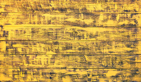 Yellow painted wooden planks - Wood background with golden brush strokes -  Horizontal boards Banco de Imagens