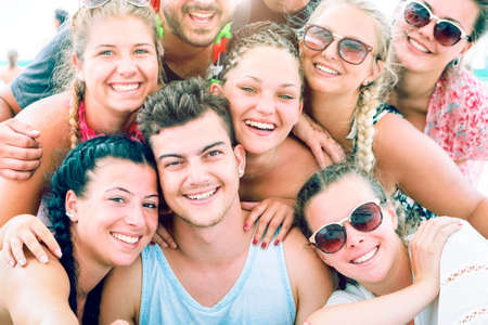 Happy millennials friends faces smiling - Group of teenagers having fun moments taking selfie outdoors on summer holidays - Cocept of teenage friendship , togetherness - Soft blue filter look - image