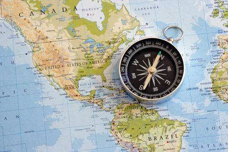 Magnetic compass and world map Stock Photo