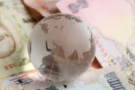 rupees: globe kept on indian rupees Stock Photo