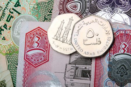 close up of 50 fils coins and dirham notes Stock Photo