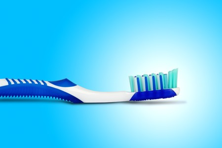 germ free: Tooth brush in blue background