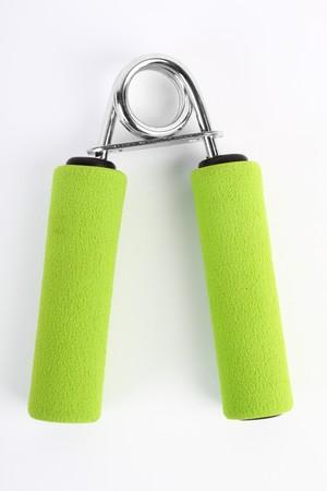 hand exercising equipment - hand grip on white background Stock Photo - 6997912