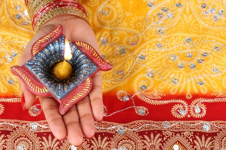 festival occasion: Handmade Diwali Diya Lamp in Hand Stock Photo