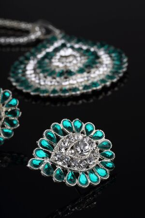 Intricate Diamond Earrings Closeup photo