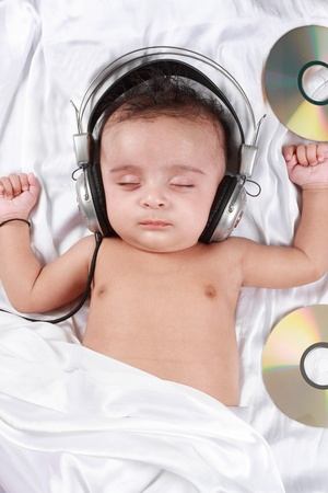 2 Month old baby listening to music with headphones photo