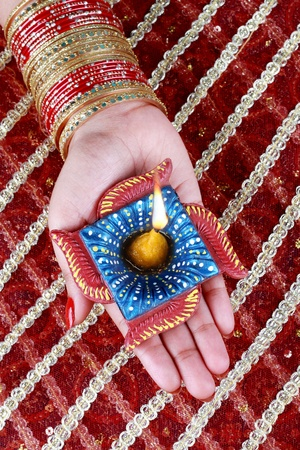 Handmade Diwali Diya in Hand photo