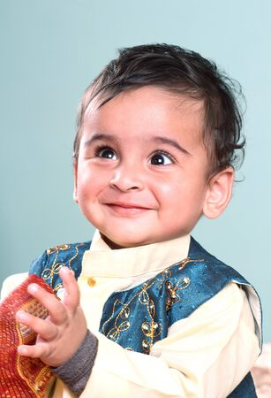 Smiling Indian Baby in Tranditional Clothing photo