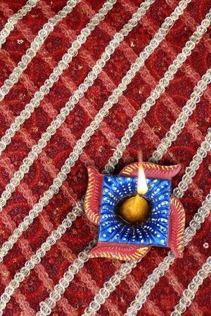 swastik: Handmade Indian Diwali Diya in Swastik Shape Stock Photo