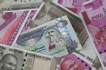 UAE Dirhams between Indian New Currency Bank Notes Stock fotó