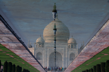 Reflection of Taj Mahal in Fountain Water, Agra, India Stock Photo