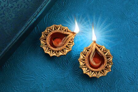 Beautiful Golden Diwali Diya Lamp Lights on Blue Background 免版税图像