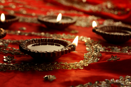Indian Diwali Diya with Festive Lights and Bokeh