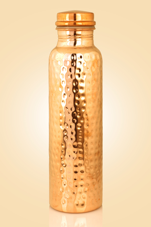 Traditional Indian Copper Mineral Water Bottle Isolated